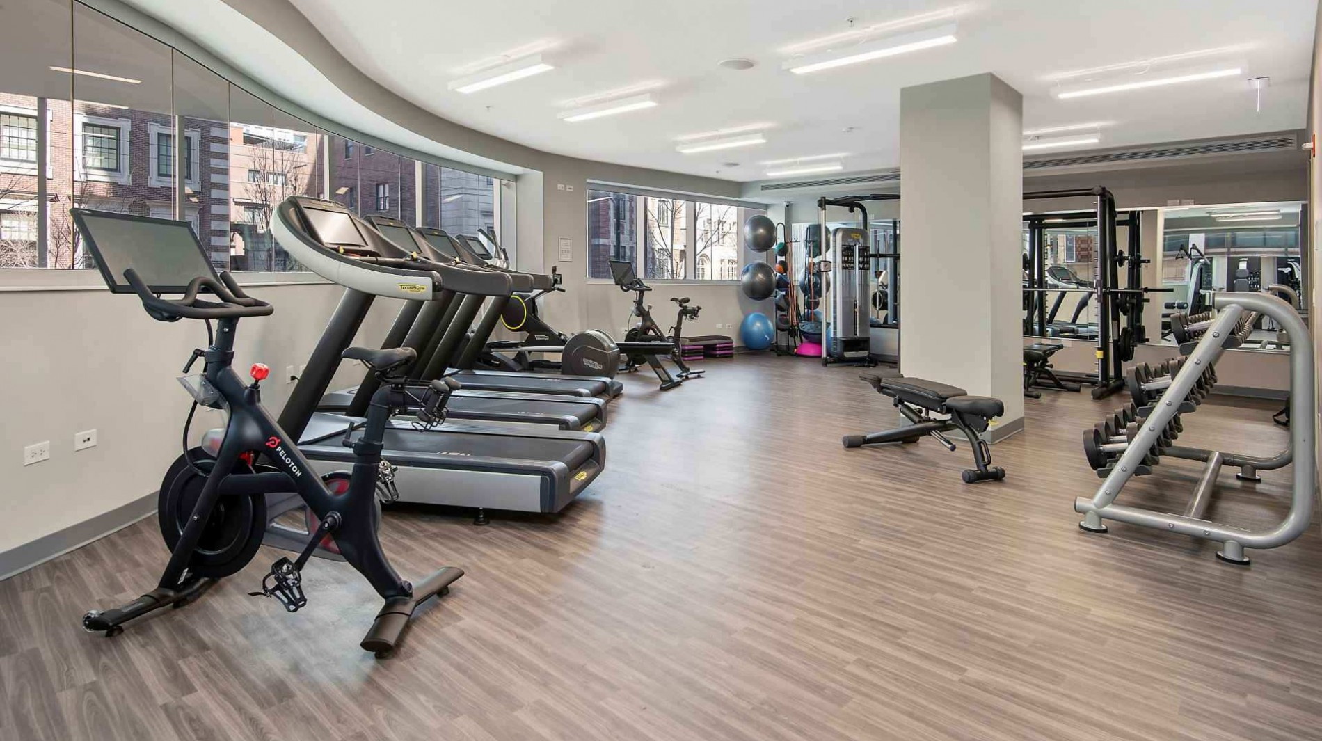 Resident fitness center with array of cardio and weightlifting equipment.